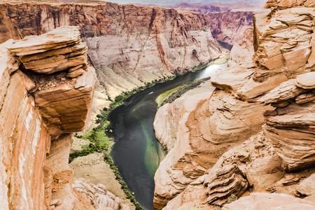 downstream: Horseshoe Bend left hand side, Glen Canyon, Page, Arizona, AZ, USA - An extraordinary view of the Horseshoe Bend, an Erg horseshoe-shaped and the Colorado River Stock Photo