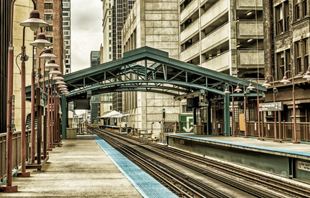 Metro station surrounded by buildings at The Loop - Black Gold Artistic Effect - Chicago, CHI, Illinois, USA Stock Photo