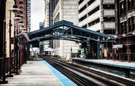 Metro station surrounded by buildings at The Loop - Bleached Portrait Artistic Effect - Chicago, CHI, Illinois, USA