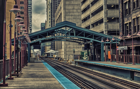 Metro station surrounded by buildings at The Loop - Dark Cross Processing Artistic Effect - Chicago, CHI, Illinois, USA Stock Photo