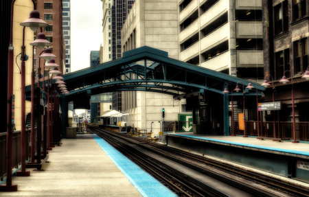 Metro station surrounded by buildings at The Loop - Sepia Glow Artistic Effect - Chicago, CHI, Illinois, USA Stock Photo