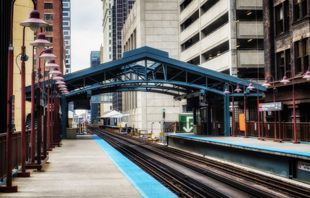 Metro station surrounded by buildings at The Loop - Soft and Grainy Artistic Effect - Chicago, CHI, Illinois, USA