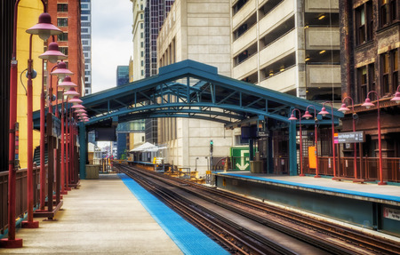 Metro station surrounded by buildings at The Loop - Warm Sunset Artistic  Effect - Chicago, CHI, Illinois, USA Stock Photo