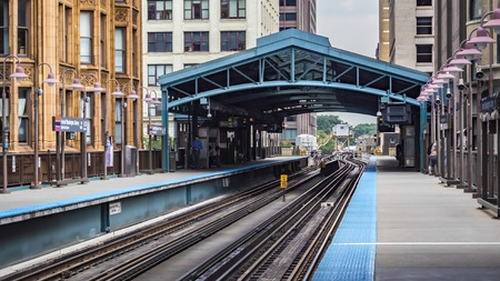 Colorful metro station surrounded by buildings at The Loop - Chicago, CHI, Illinois, USA