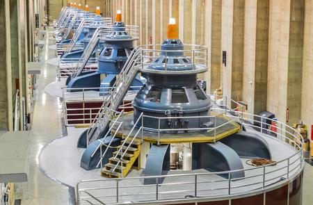Hoover Dam power plant turbines with america flag - August 10th, 2017 - Arizona, AZ, USA