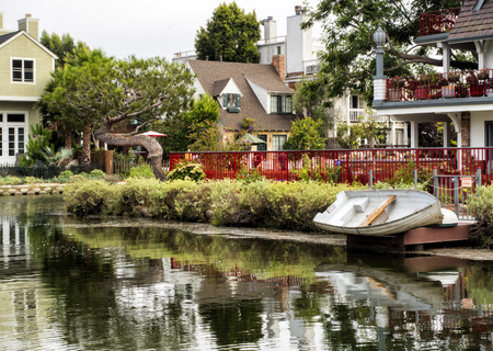 Venice Canals, cosy colorful house with boat on the 13th August, 2017 - Venice Beach, Los Angeles, California, USA Editorial