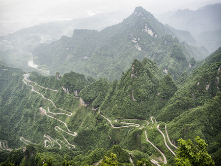 A view of the dangerous  99 curves at the Tongtian Road to Tianmen Mountain, The Heavens Gate at Zhangjiagie, Hunan Province, China, Asia
