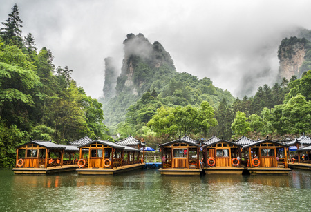 Baofeng Lake Boat Trip in a rainy day with clouds and mist at Wulingyuan, Zhangjiajie National Forest Park, Hunan Province, China, Asia Editorial
