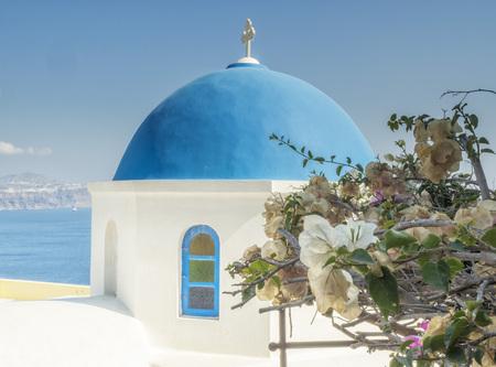 White Church with blue dome at Oia, Santorini, Greek Islands