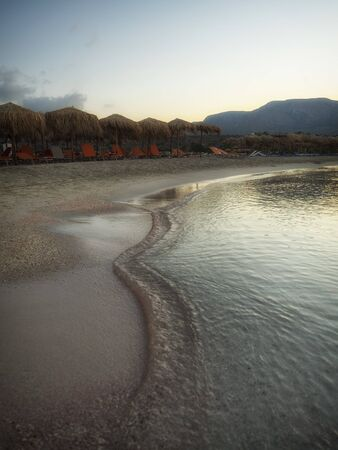 Pink sand and turquoise water early in the morning at Elafonisi Lagoon, Crete Island, Greece