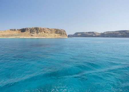 Balos Lagoon Blue sea, hills and boat, transparent water as a swimming pool, Crete Island, Greece