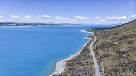 Mount Cook Road and Pukaki Lake, drone aereo view, New Zealand, South Island, NZ
