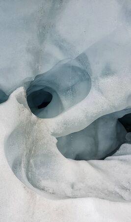 Franz Josef Glacier crampons hike through the blue glacier ice - New Zealand, South Island, NZ
