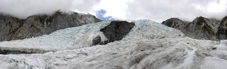 Franz Josef Glacier crampons hike through the blue glacier ice - New Zealand, South Island, NZ