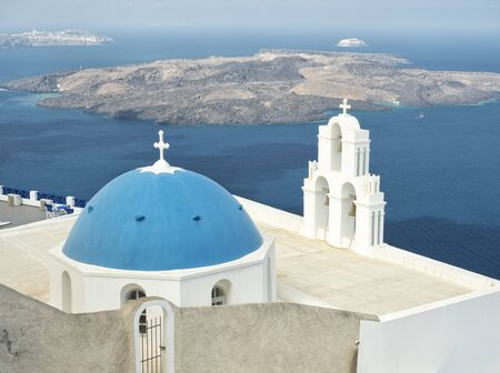 White Church with blue dome at Oia, Santorini, Greek Islands