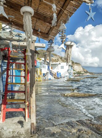 Klima Fishing Village with bright coloured wooden doors - Milos Island - Greece