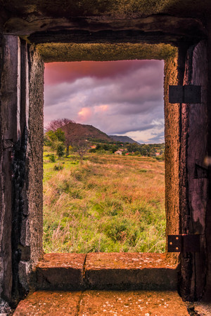 framing: A beautiful frame for the countryside. Its framing a tree and the mounts of Etna.