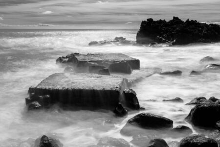 b w images: The geometries of the rocks and water in and out of the narrow rocky canals. Long time exposure and silk effect for this picture. Stock Photo