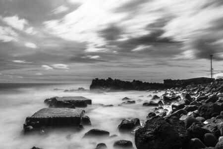 nature photo: The geometries of the rocks and water in and out of the narrow rocky canals. Long time exposure and silk effect for this picture. Stock Photo
