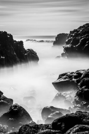 The geometries of the rocks and water in and out of the narrow rocky canals. Long time exposure and silk effect for this picture. Stock Photo