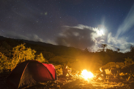 excursions: Evocative nocturnal landscape of the tent camp in one of our excursions. Stock Photo