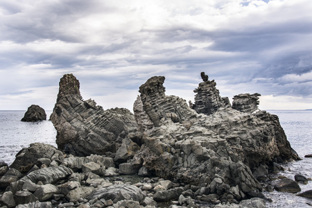 basalt columnar in Acitrezza Sicily  with sky background and sea