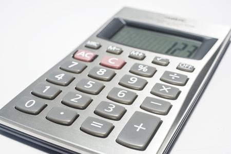 compute: Calculator on white Stock Photo