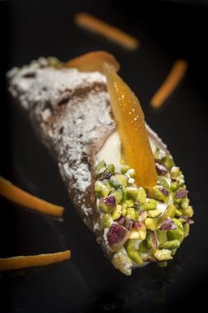 Sicilian cannolo with ricotta cheese orange zest and chopped pistachios