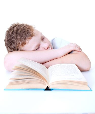 boy fell asleep reading a book Stock Photo