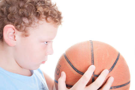 keep your hands: boy with a basketball on a white background