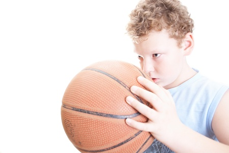 boy with a basketball on a white background