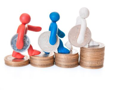 multicolored plasticine figures are coins on the steps up