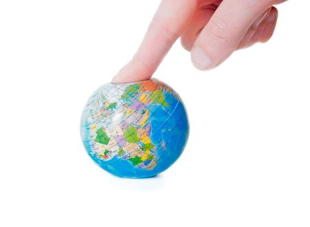human hand presses the globe Stock Photo