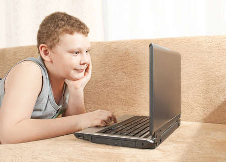 A boy with a computer Stock Photo - 12306036