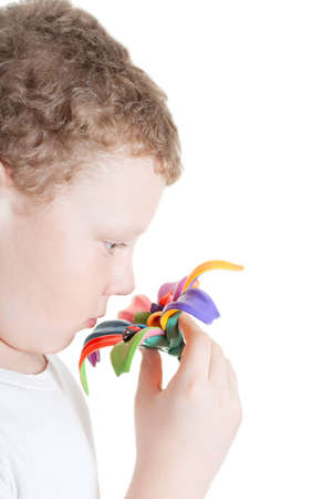 plasticine boy gives a flower in his hand Stock Photo - 12306041