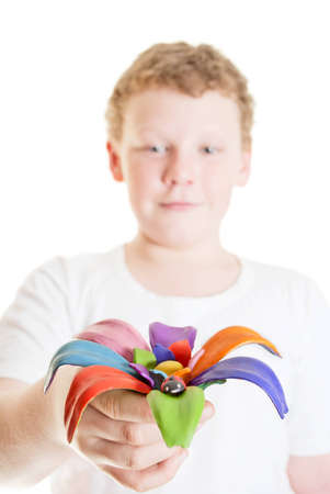 plasticine boy gives a flower in his hand