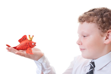 Boy holding a goldfish out of plasticine Stock Photo - 12771143