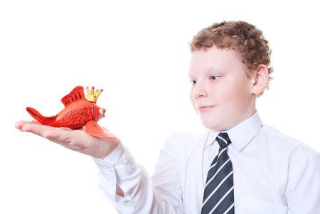 Boy holding a goldfish out of plasticine Stock Photo - 12771142