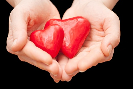 Plasticine heart in hand on a black background Stock Photo - 13007026