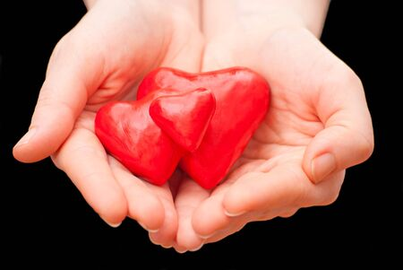 Plasticine heart in hand on a black background Stock Photo - 13007020