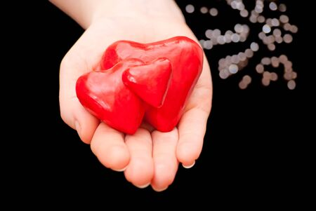 Plasticine heart in hand on a black background Stock Photo - 13006960