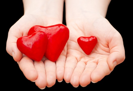 Plasticine heart in hand on a black background Stock Photo - 13006862