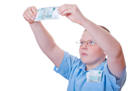 The boy looks at the bill on a white background