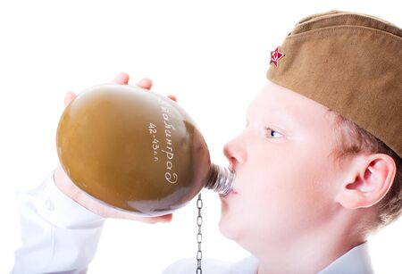 A boy drinks from a flask Stock Photo - 13265582