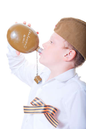 A boy drinks from a flask Stock Photo - 13265581