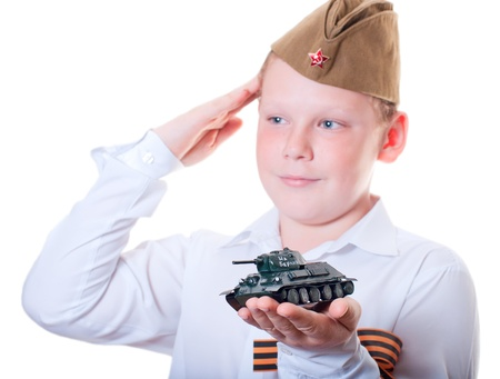 The boy is holding a plasticine model of the tank Stock Photo - 13265536