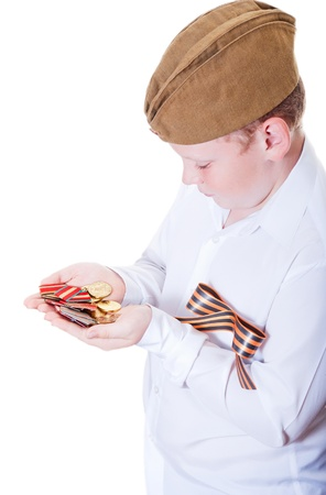 The boy is holding a Medals on a white background Stock Photo - 13265550