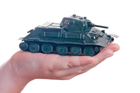 plasticine model of a tank in the palm of your hand Stock Photo - 13566226