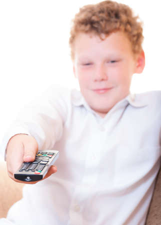 A teenager with a remote control Stock Photo - 14188736