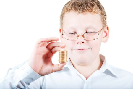 Boy holds a stack of coins Stock Photo - 16217318